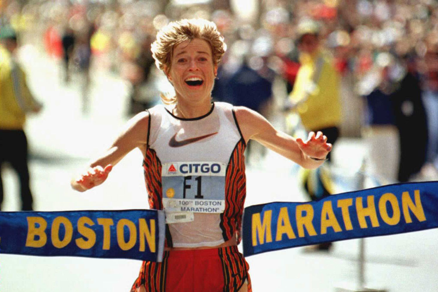 Uta Pippig crosses the finish line to win the women's division in the 100th running of the Boston Marathon.