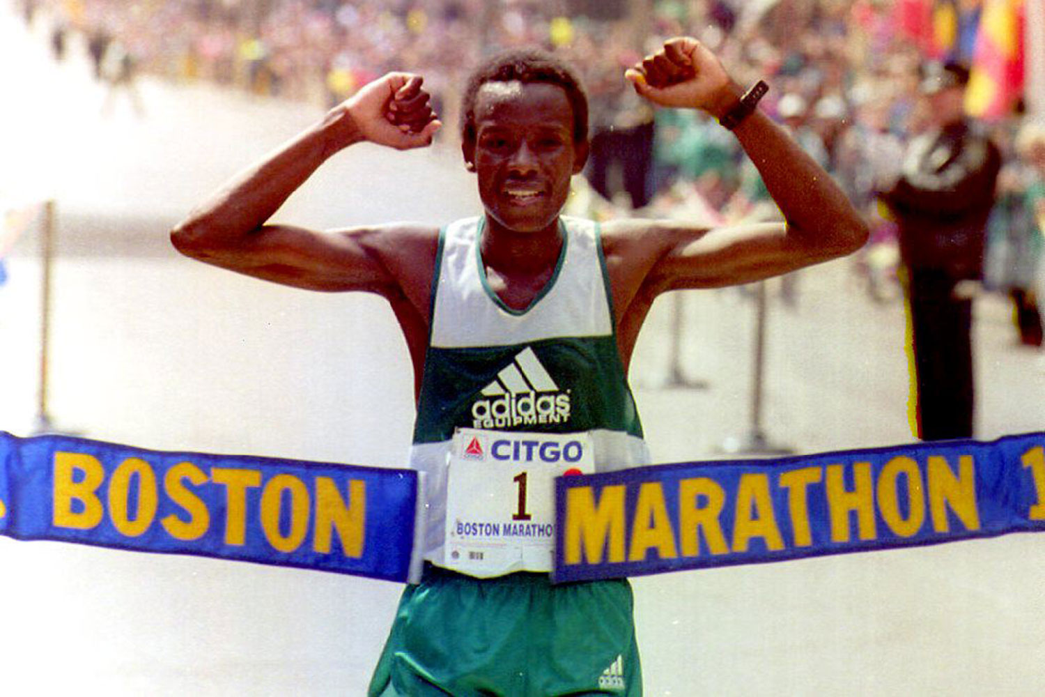 Ibrahim Hussein raises his arms as he crosses the finish line to win the Boston Marathon in 1992.
