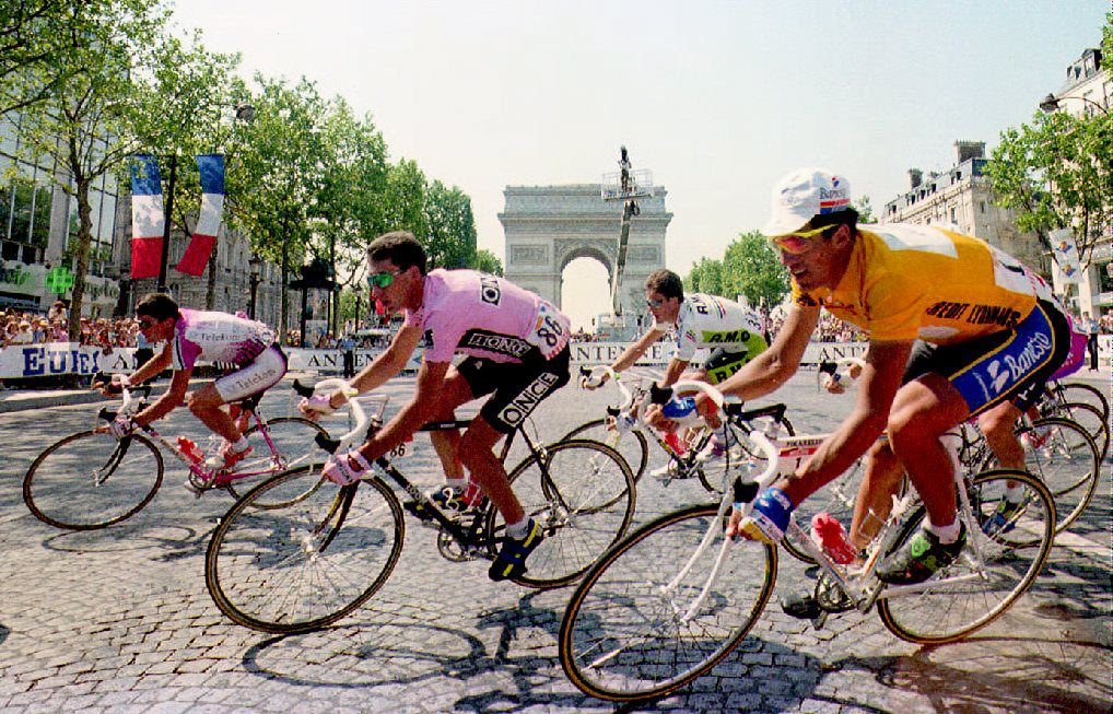 Spanish cycling champion Miguel Indurain (right) takes one of the final turns of the 79th Tour de France on the Champs Elysees in July 1992.