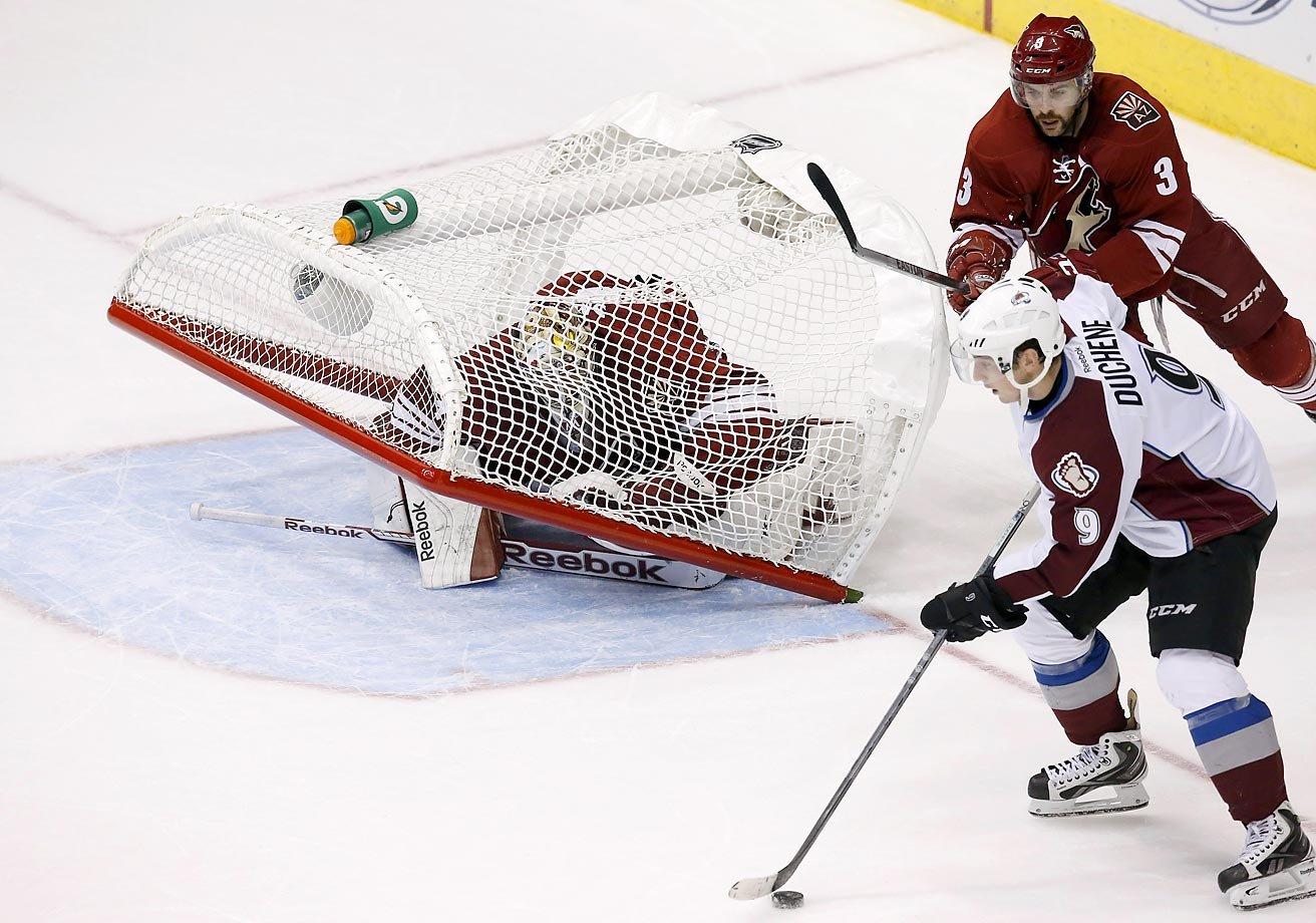 Mike Smith of the Arizona Coyoteshas the goal fall over on him in overtime during a 4-3 loss to the Colorado Avalanche.