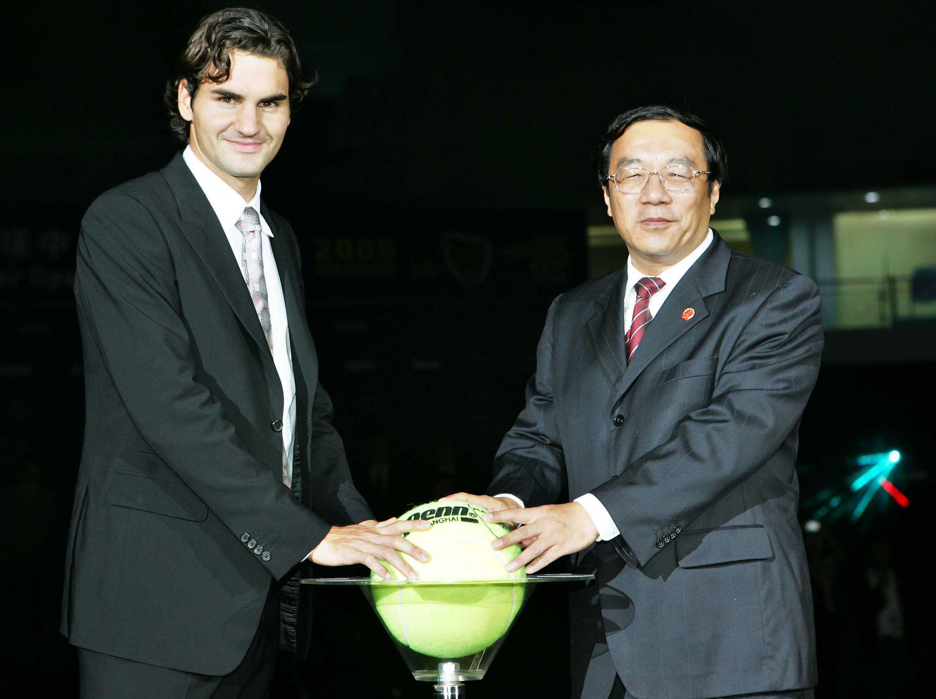 Federer helps to open the venue.