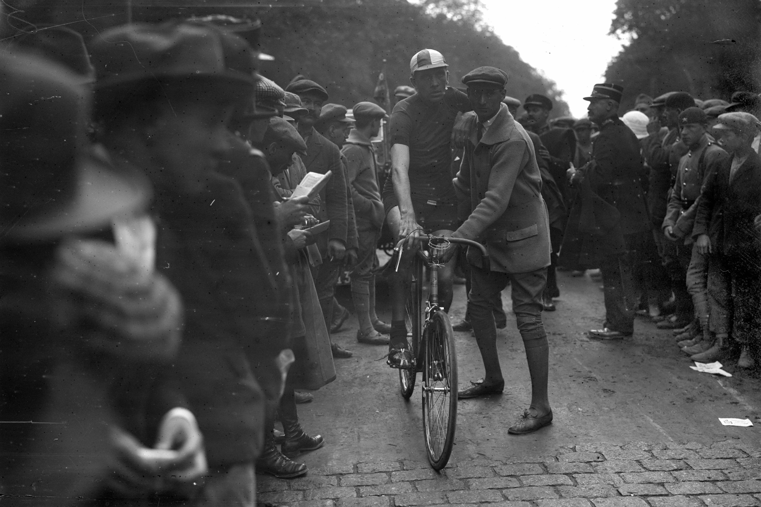 "Henri Pelissier, 1919 winner, holds the records for the slowest victory – 12 hours and 15 minutes on roads still devastated by World War I, described at the time by Victor Breyer, cycling editor for Le Vélo: ""Shell-holes one after the other, with no gaps, outlines of trenches, barbed wire cut into one thousand pieces; unexploded shells on the roadside, here and there, graves. Crosses bearing a jaunty tricolour are the only light relief."""