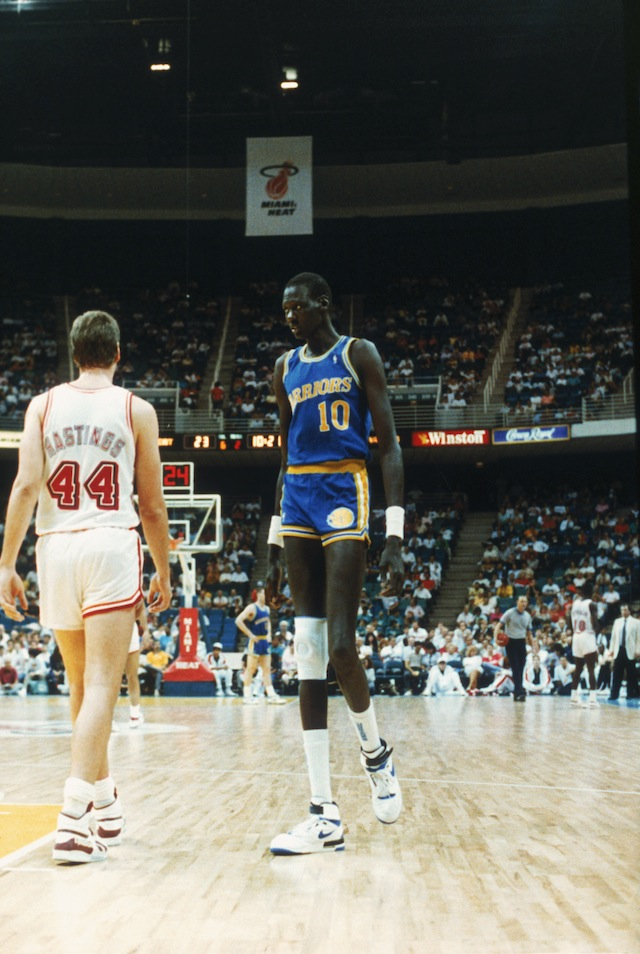 Manute Bol #10 of the Golden State Warriors looks on during a game against the Miami Heat in Miami, Florida.