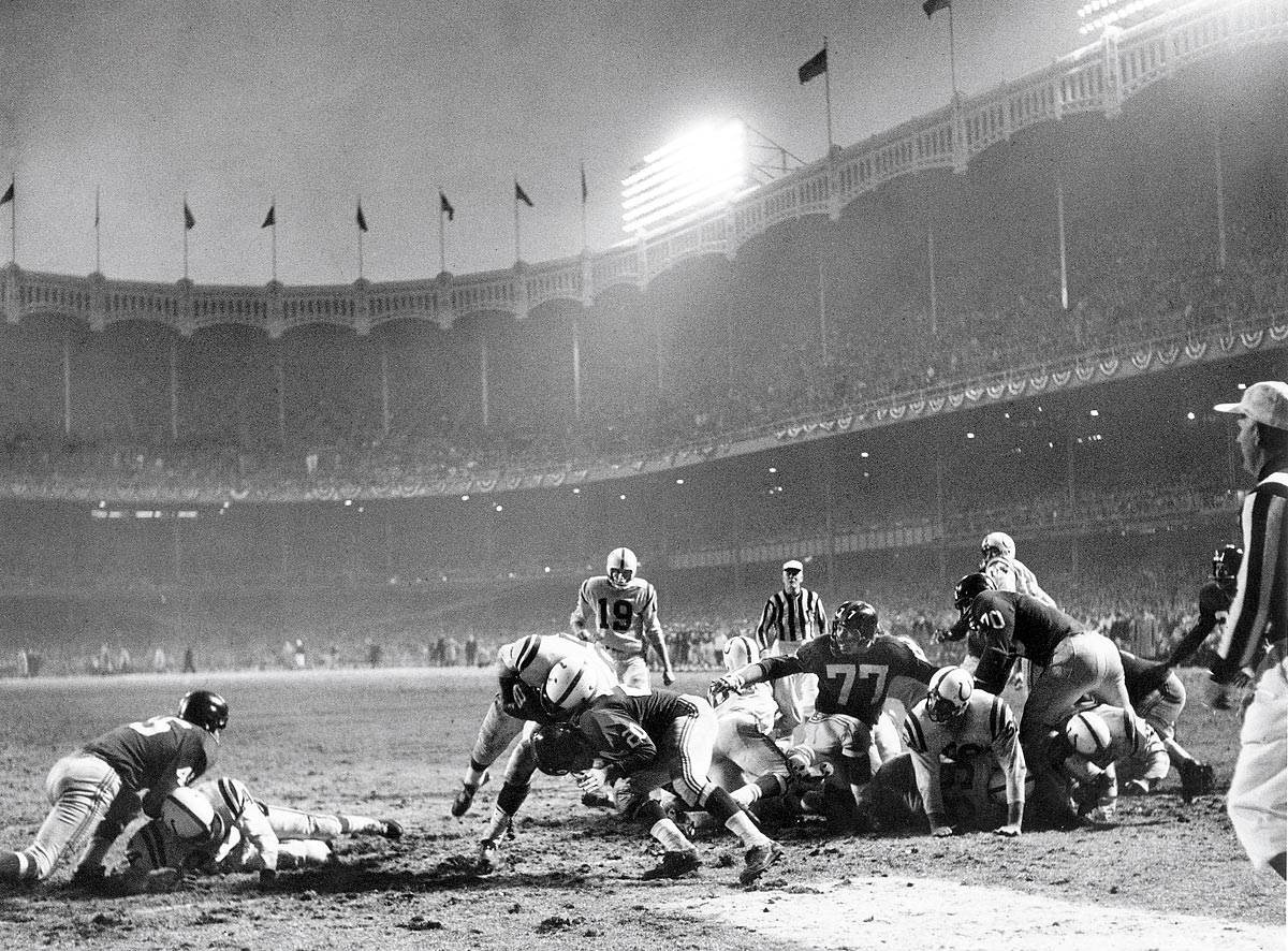 NFL Championship Game, Dec. 28, 1958 | Baltimore Colts fullback Alan Ameche plows through New York Giants defensive back Jim Patton for the winning touchdown in overtime of the 1958 NFL Championship Game, otherwise known as `The Greatest Game Ever Played.'