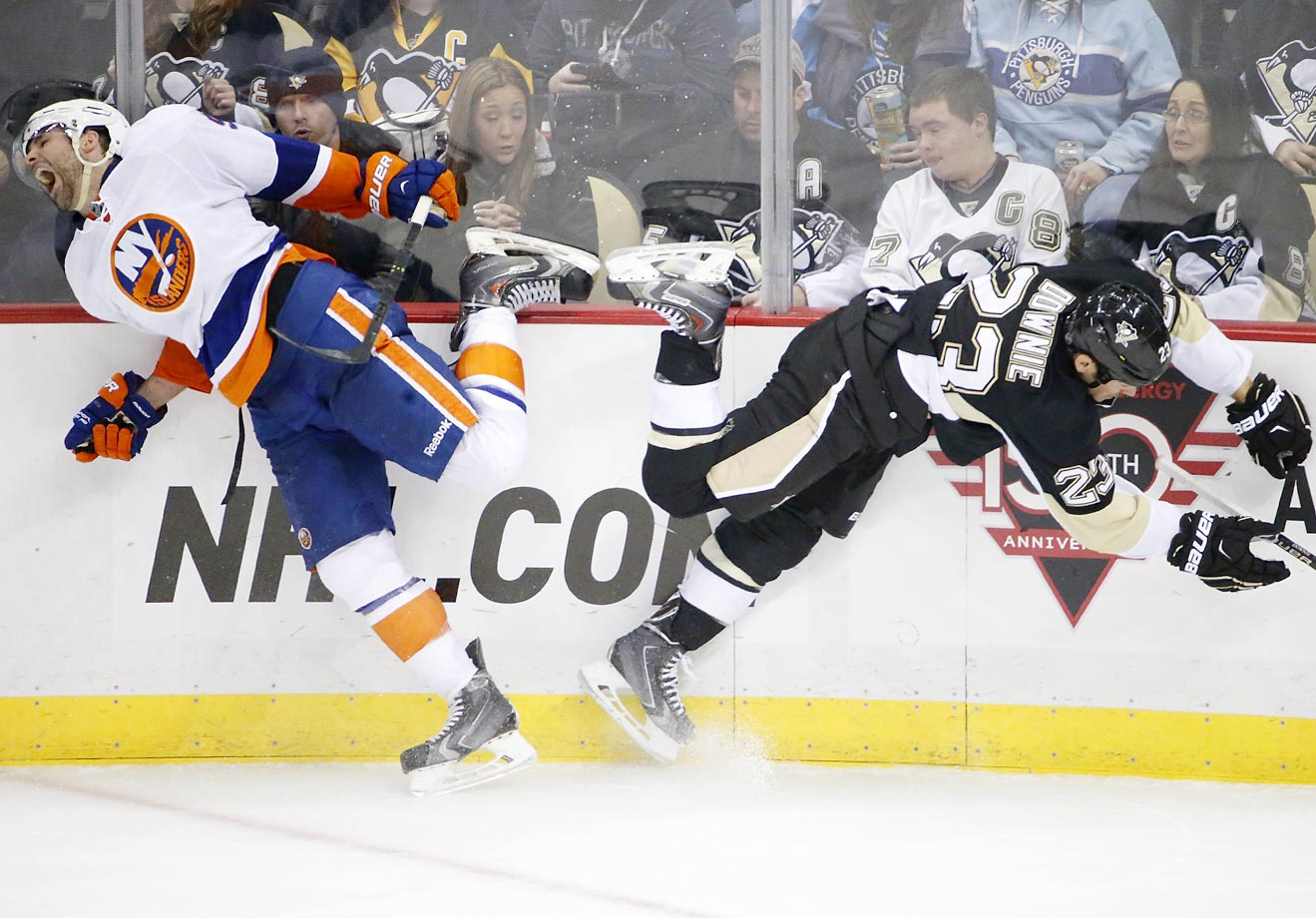 Steve Downie of the Penguins collides with Johnny Boychuk of the Islanders.