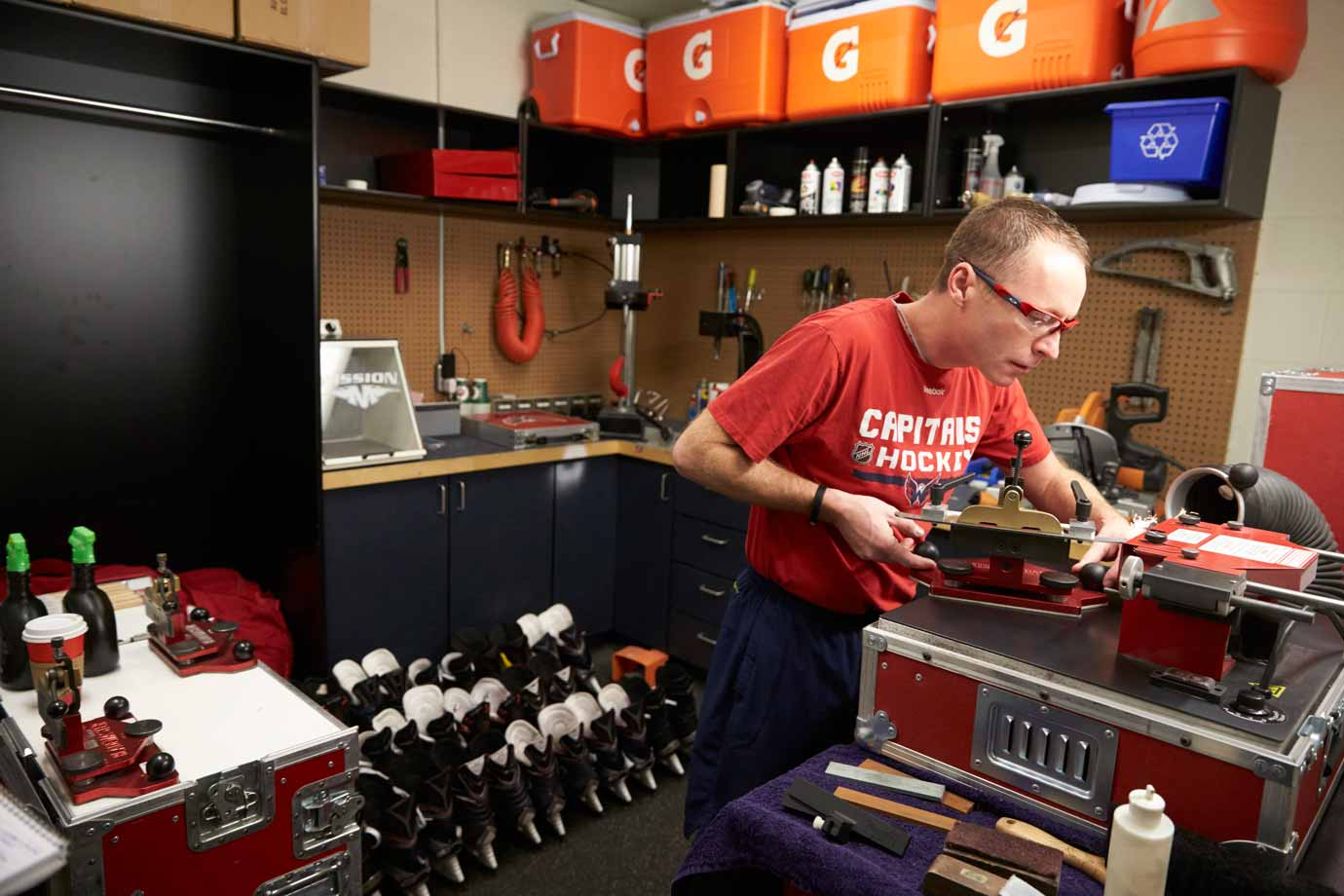 The staff gets to work bright and early the next day. By 7:49 a.m. equipment manager Brock Myles is sharpening skates.
