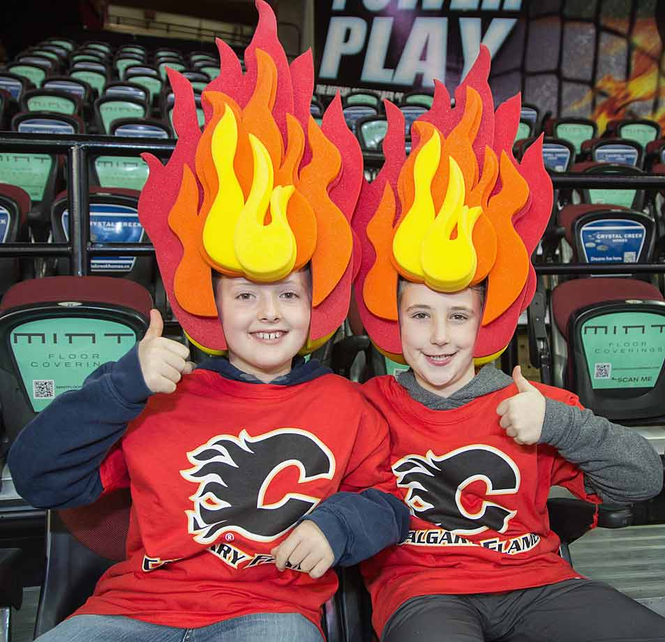 Flaming redheads warm up before a game against the Nashville Predators at Calgary's Scotiabank Saddledome on October 31, 2014.