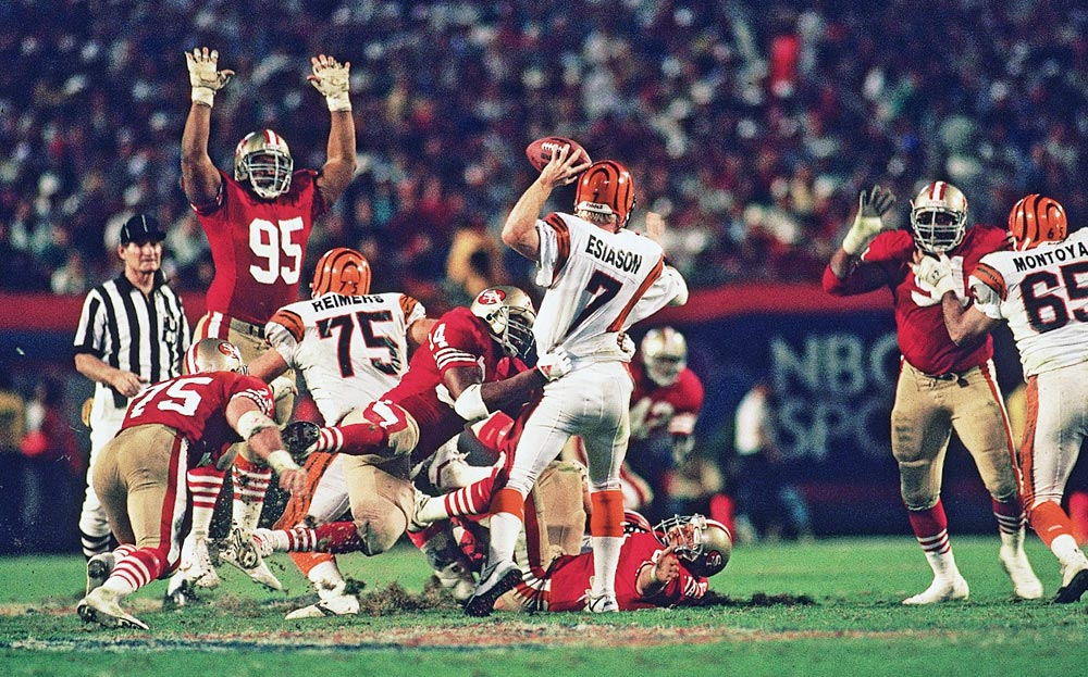 San Francisco 49ers defensive tackle Michael Carter tugs at Boomer Esiason as the Cincinnati Bengals quarterback attempts to pass. The 49ers defense limited Esiason to just 11-of-25 passing and 144 yards with no touchdowns and one interception in San Francisco's 20-16 win.