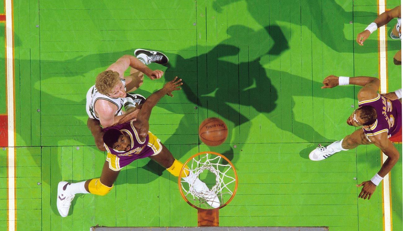 Rival stars Magic Johnson of the Lakers and Larry Bird of the Celtics battle beneath the rim in Game 1 of the 1985 Finals. L.A. pulled the series out in six games thanks to vintage play from 37-year-old Kareem Abdul Jabbar.
