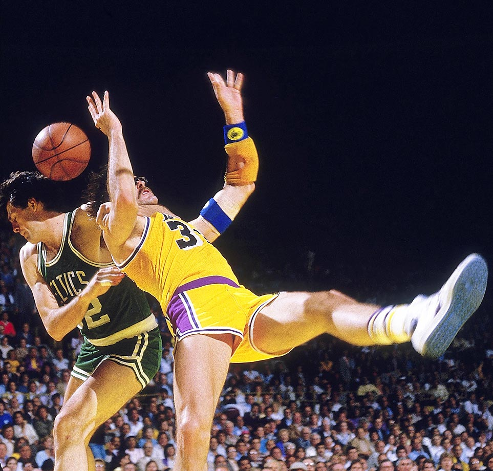 Kevin McHale of the Celtics delivers an extremely hard foul on Lakers forward Kurt Rambis in Game 4. The Boston-Los Angeles rivalry was reignited with an epic seven-game clash between the teams.