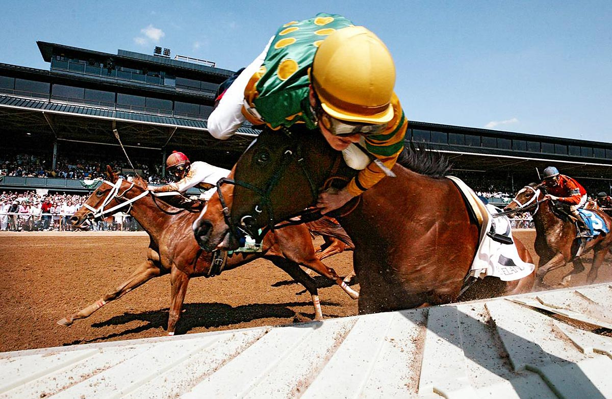 Keeneland Race Course, April 28, 2006 | Jockey Julien Leparoux tries to hold on to the bridle as he is catapulted off Sanibel Storm, which hit the rail during the stretch run. The jockey and horse were both uninjured.