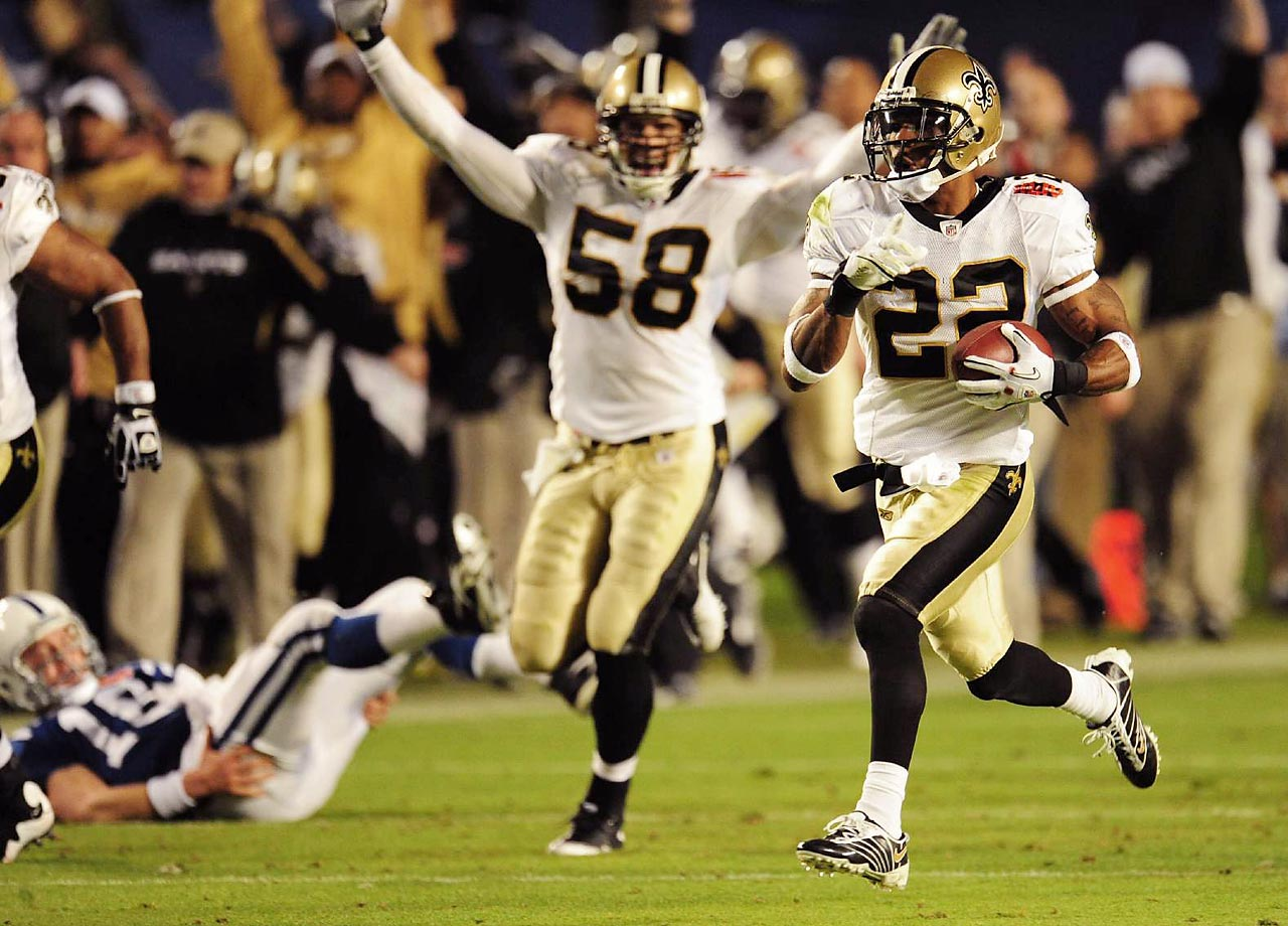 Tracy Porter races with his interception return, taking it 74 yards for a touchdown. The New Orleans cornerback picked off Indianapolis Colts quarterback Peyton Manning, and his score iced the Saints' 31-17 win.