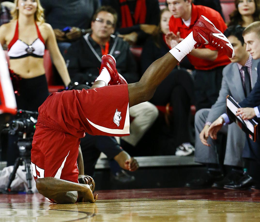 Arkansas forward Jacorey Williams flips over after diving for a loose ball in a game against Georgia.  Arkansas  won 79-75.