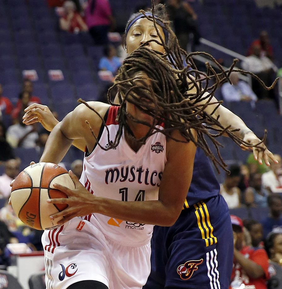 Washington Mystics guard Tierra Ruffin-Pratt drives to the basket past Indiana Fever guard Briann January during a WNBA game.