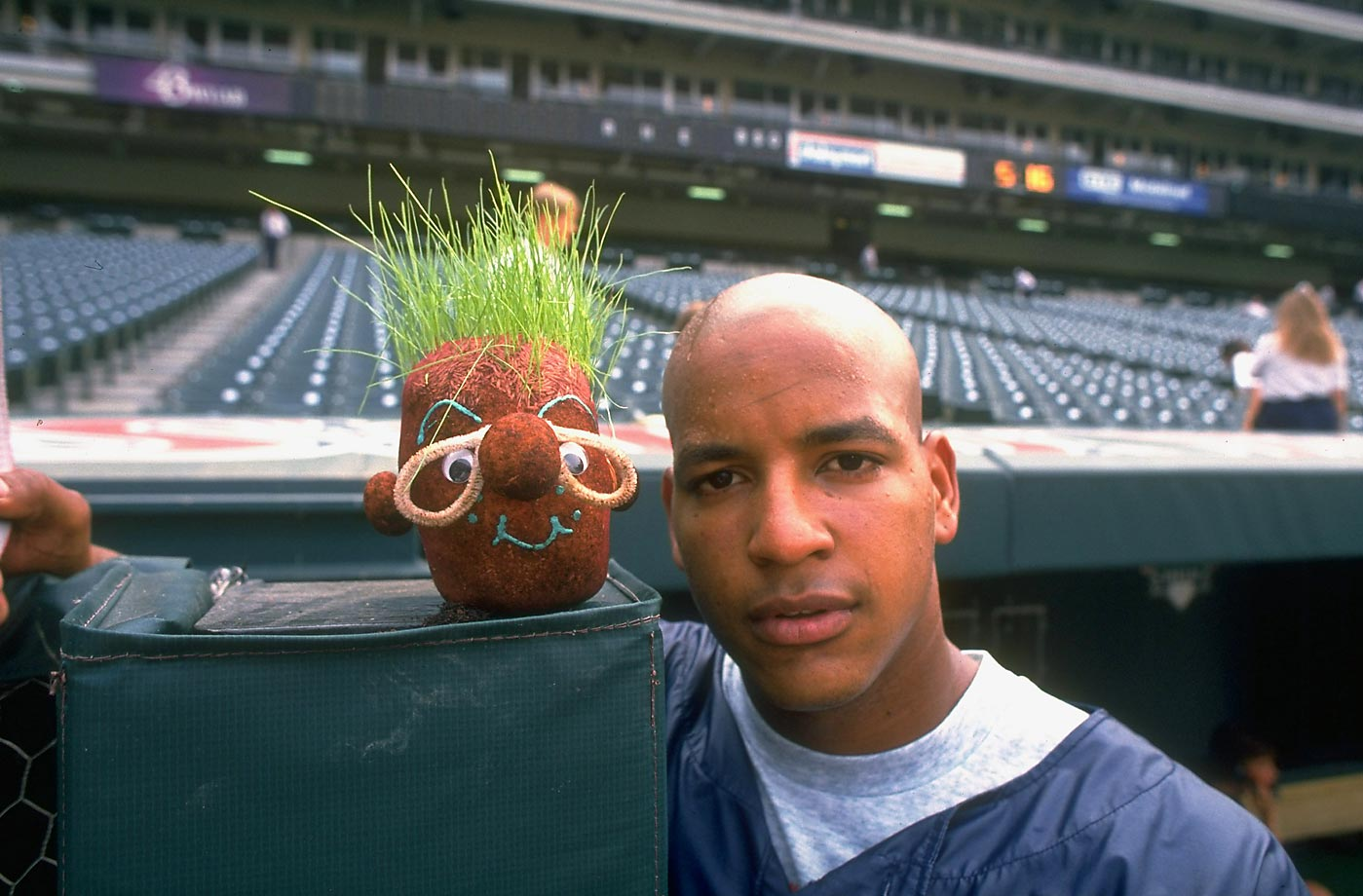 Seen without his trademark dreadlocks, a bald Manny Ramirez stands next to a hairy little effigy in this 1995 photo. Eighteen years later, a minor league contract with a Texas Rangers affiliate would require Ramirez to once again part with his hair.