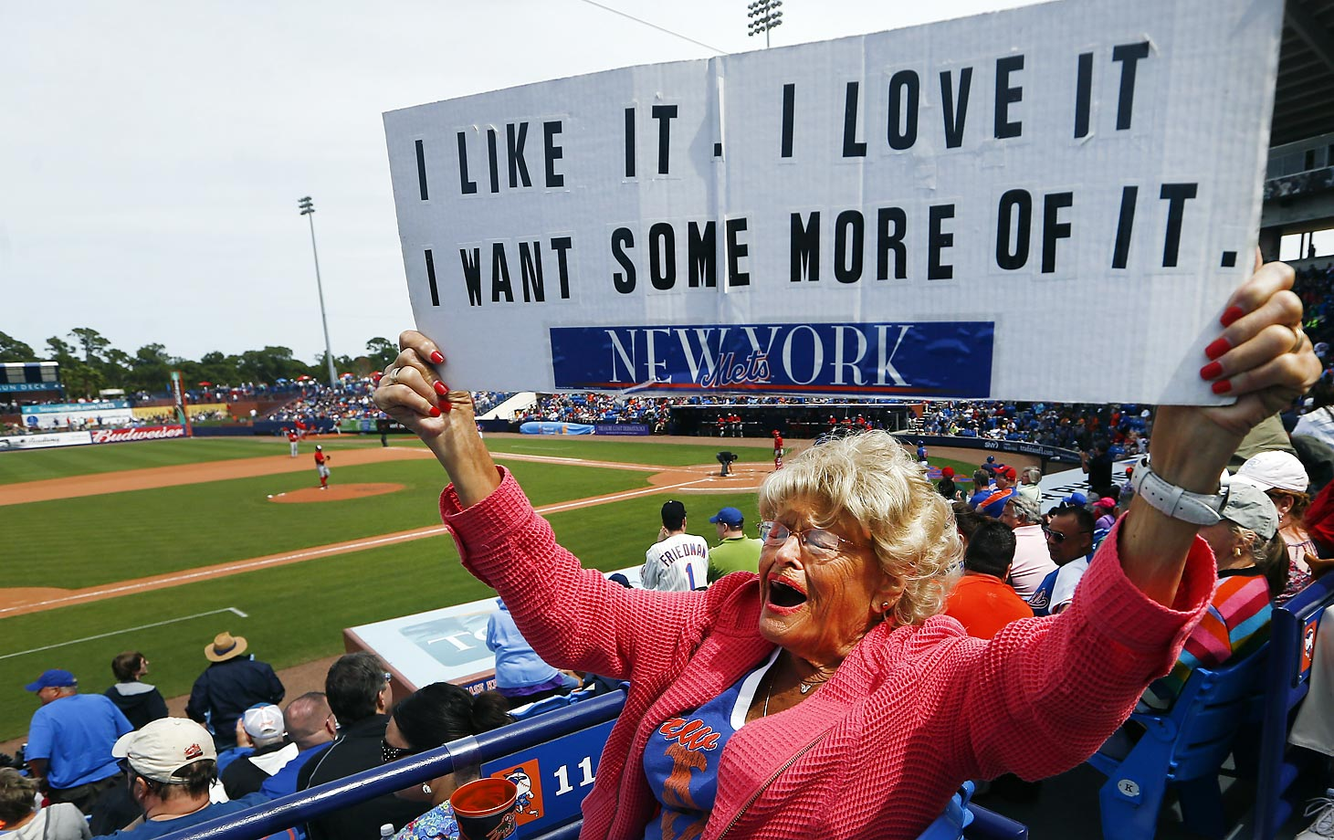 New York Mets fan Grace Velez, of Fort Pierce, Fla., expresses herself through sign following a Spring Training home run in Port St. Lucie, Florida.