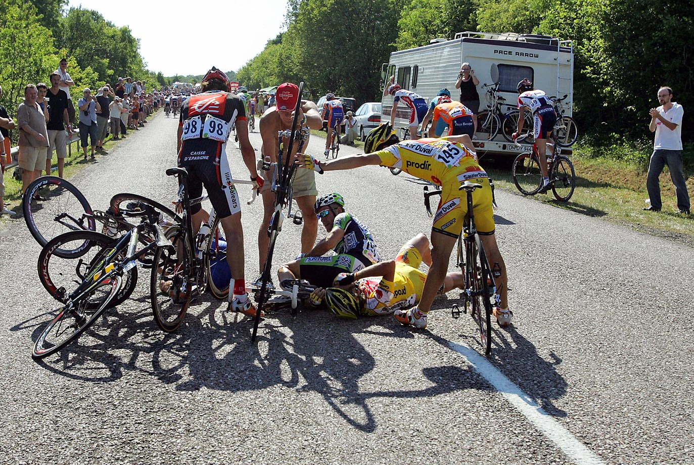 Hot days and long stages, such as this 228.5 km slog early in the 2006 Tour, lead to crashes. In addition to losing skin and blood – abrasions that adversely effect their sleep, their ability to recover – these crash victims all lost time. The need to get back on one's bike, still bleeding, then go deep in the red simply to catch the main group, adds insult to injury.