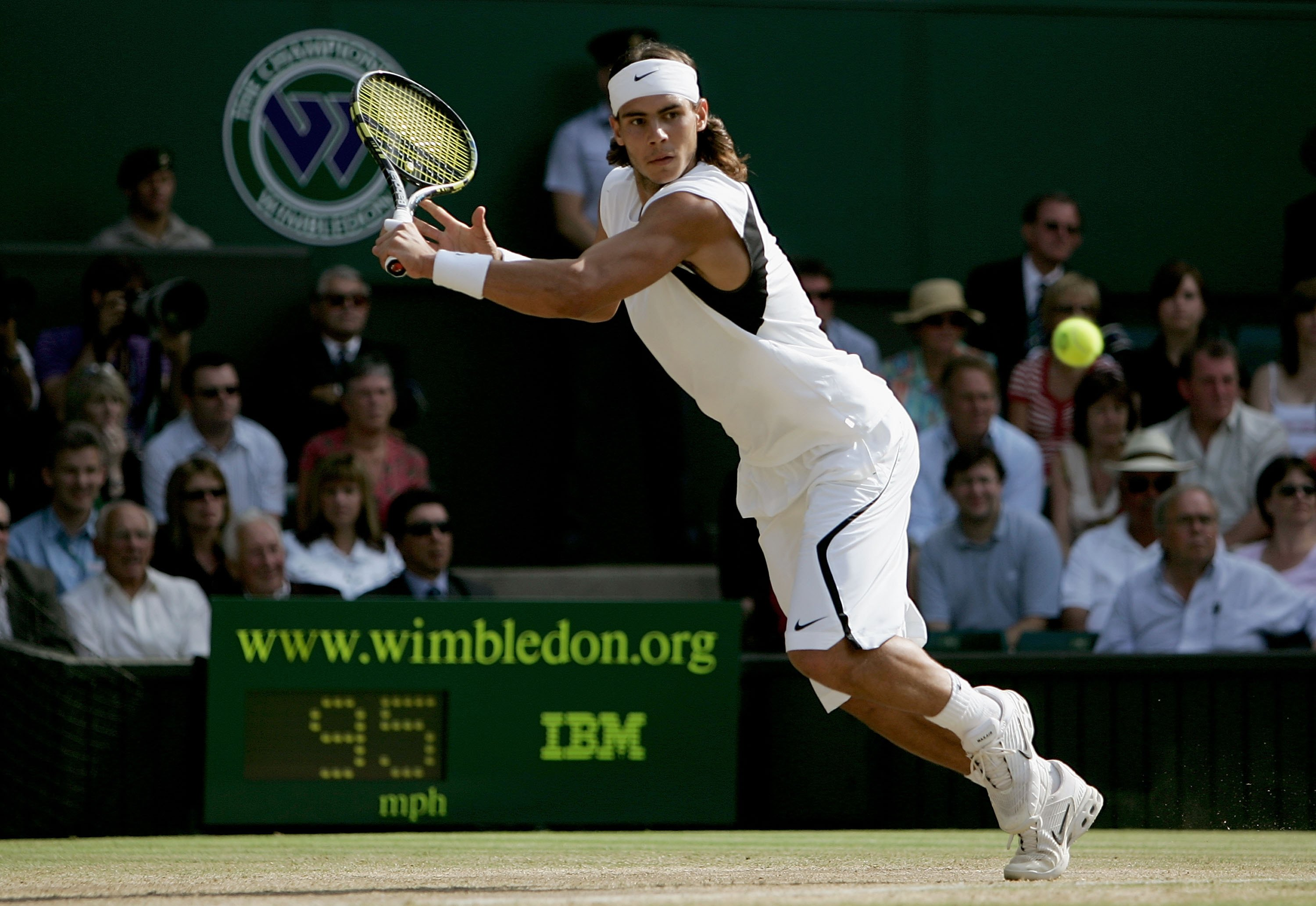 Rafa looks sleek and sharp in his Wimbledon whites, adorned with strokes of black.