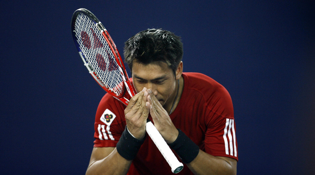 "Srichaphan gives his traditional ""wai,"" or bow to the crowd, after a match in Beijing in 2006."