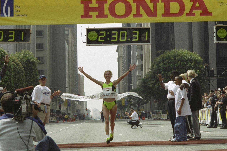 Irina Bogacheva #F8 crosses the finish line winning first place during the Los Angeles Marathon in 1999.