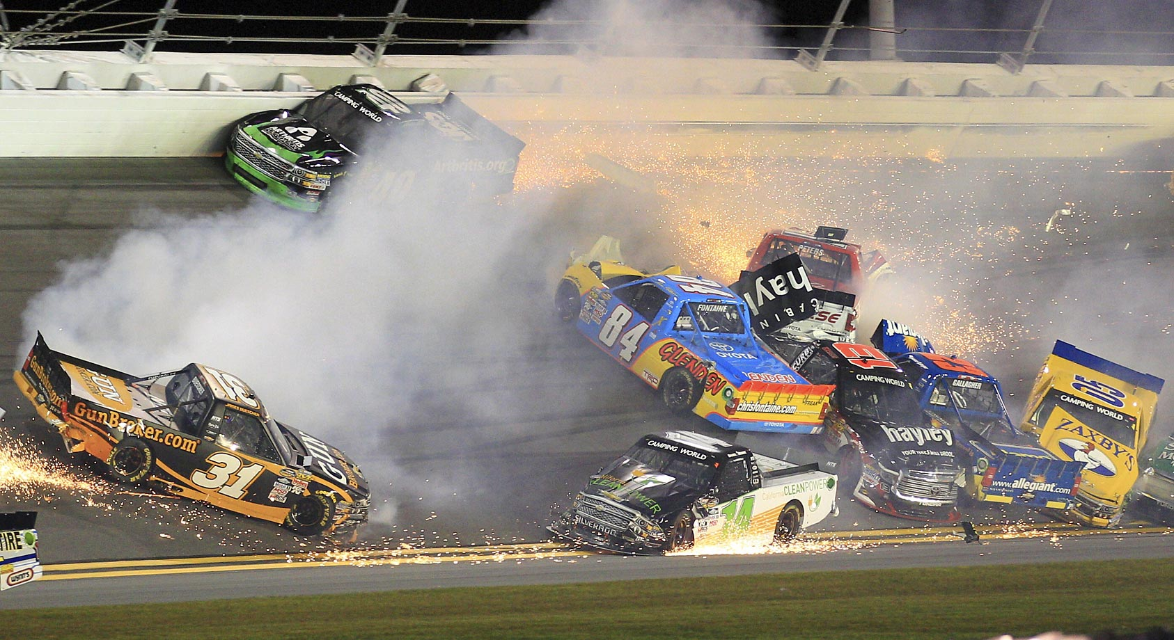 This NASCAR Truck series crash at Daytona involved drivers James Buescher (31), Todd Peck (40), Daniel Hemric (14), Chris Fontaine (84), Timothy Peters (17), Cameron Hayley (13), Spencer Gallagher (23) and John Wes Townley (05).