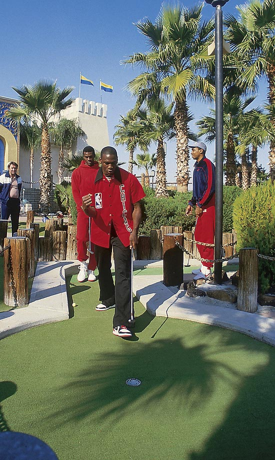 Ever a competitor, Michael Jordan celebrates sinking a putt while on a mini golf outing with Bulls teammates Orlando Woolridge and Rod Higgins in 1984. Higgins now serves as president of basketball operations for Jordan's Charlotte Bobcats.