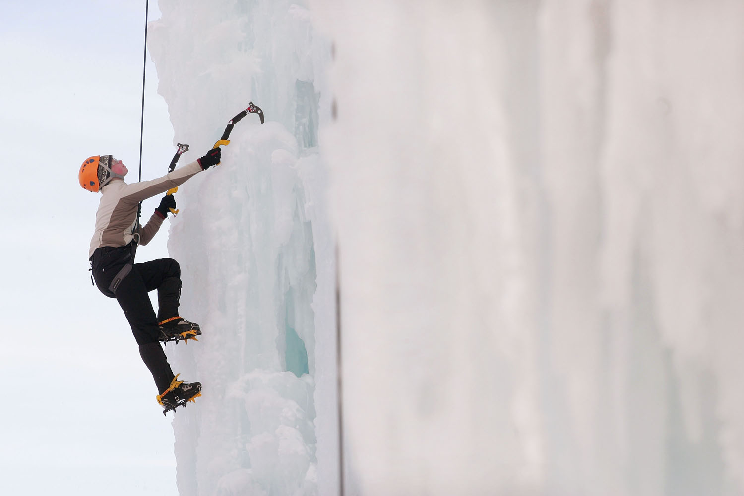 Katherine Sullivan climbs the side of an ice-covered grain silo in Cedar Falls, Iowa.