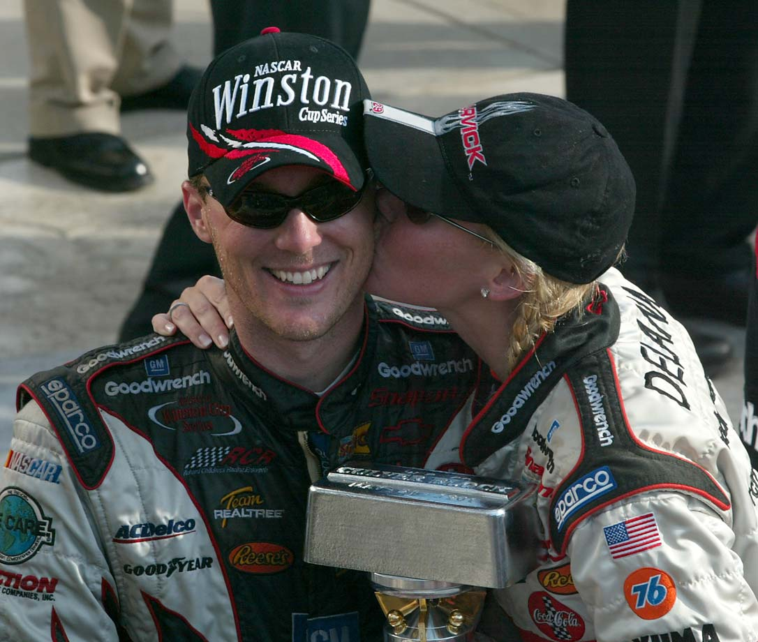 Kevin Harvick gets a kiss from wife Delana after winning  the 2003 Brickyard 400.