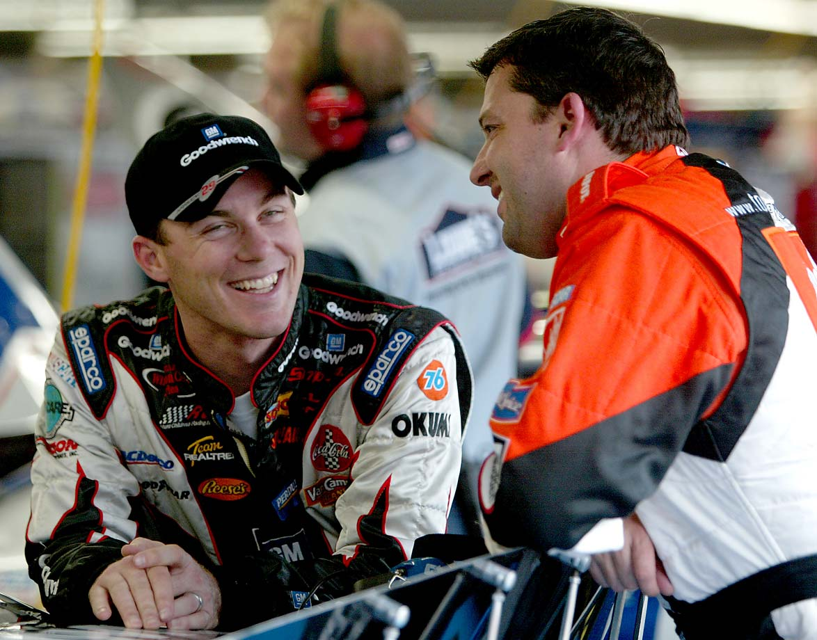 Kevin Harvick and Tony Stewart share a laugh  in the garage area during a practice session at Lowe's Motor Speedway in Charlotte in 2003.