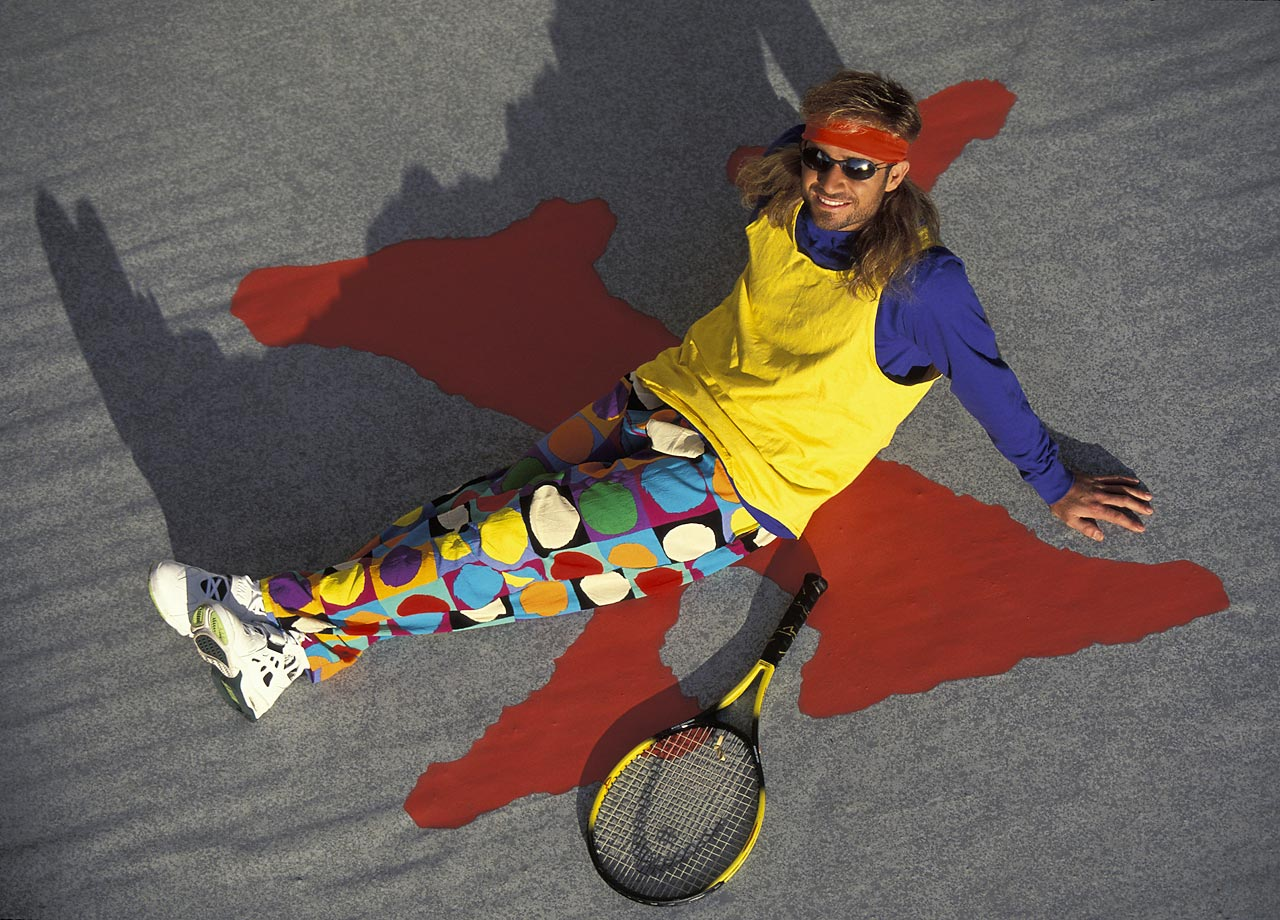Wearing an ensemble that embodies everything ridiculous about the 1990s, charismatic tennis star Andre Agassi kicks back for a Canon Rebel photo shoot in 1993.