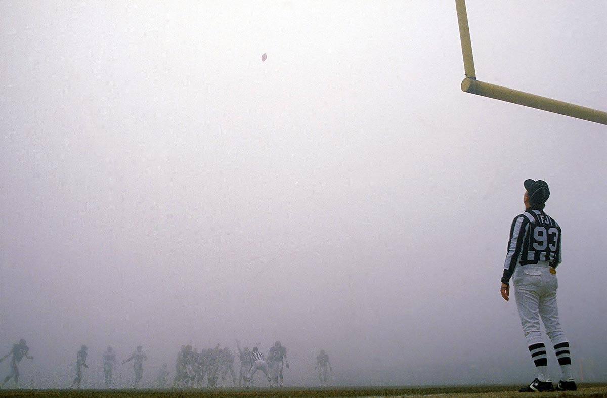 Eagles at Bears, Dec. 31, 1988 | Referee Jack Vaughn tries to follow a field goal attempt from Eagles placekicker Luis Zendejas during the Fog Bowl, a 1988 NFC divisional playoff game between the Eagles and the Bears in Chicago, Ill. A heavy sheet of fog rolled over Soldier Field during the second quarter, cutting visibility to around 10-20 yards for the remainder of the game.