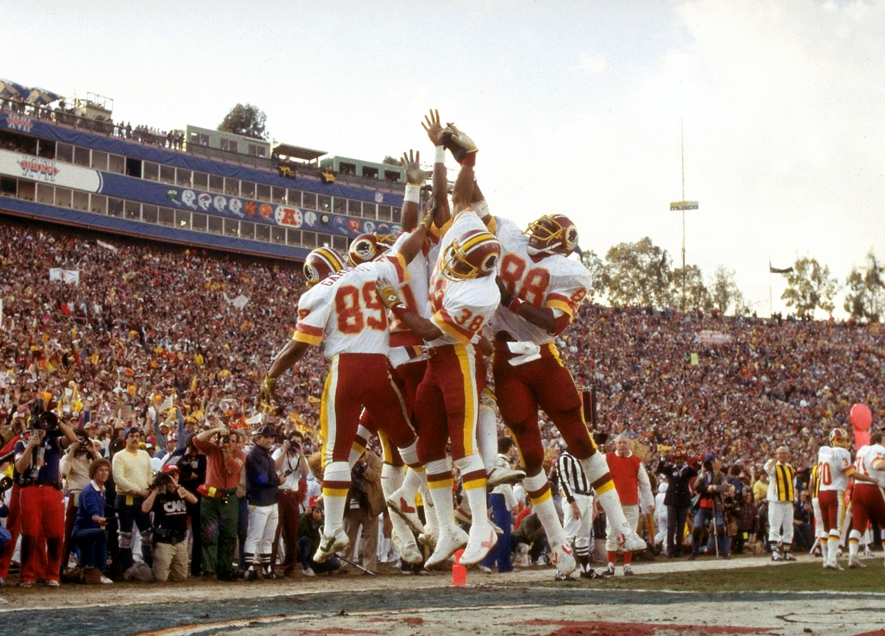 "The Washington Redskins ""Smurfs"" — a group of receivers considered to be ""undersized"" — celebrate with running back Clarence Harmon and tight end Rick Walker after a touchdown. Washington scored 17 consecutive points in the second half to defeat the Miami Dolphins 27-17."