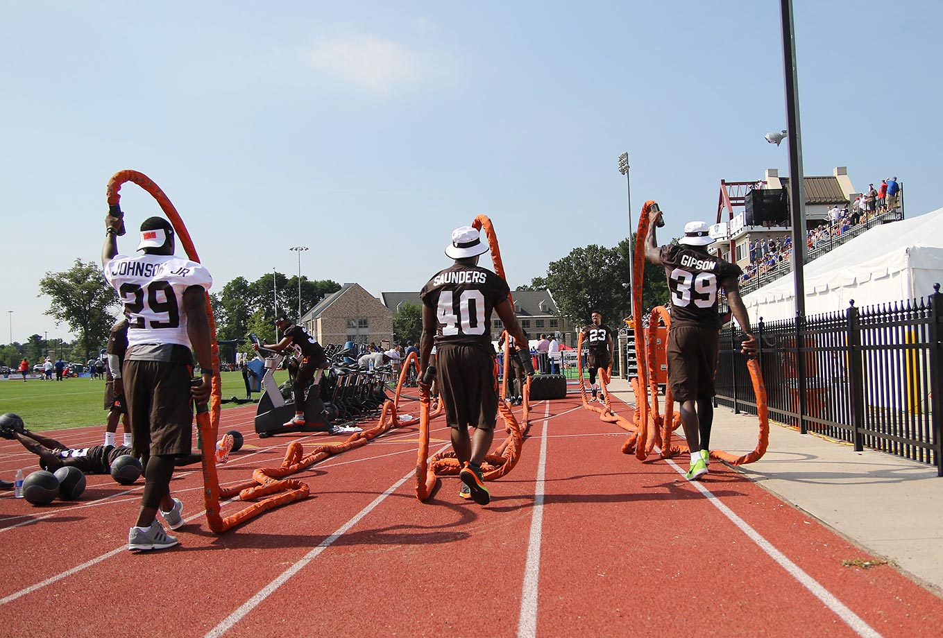 Cleveland running back Duke Johnson Jr., (29), defensive back De'Ante Saunders (40) and defensive back Tashaun Gipson (39) work out at St. John Fisher College in Pittsford, N.Y.