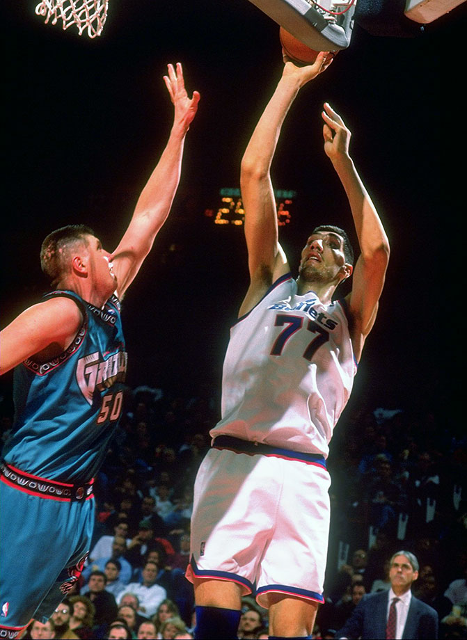 "At 7'7"", Muresan is the tallest player in the NBA history, along with the late, great Manute Bol. Muresan earned the 1995-96 Most Improved Player award after averaging 14.5 points, 9.6 rebounds, 2.2 blocks per game while making a league-leading 58.4% of his field goals. — Runners-up: Vladimir Radmanovic, Jake Voskuhl"