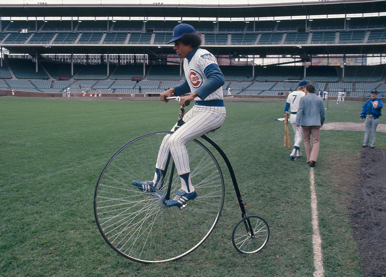 Cubs outfielder Jose Cardenal demonstrates the primary form of transportation from when Wrigley Field was first built.