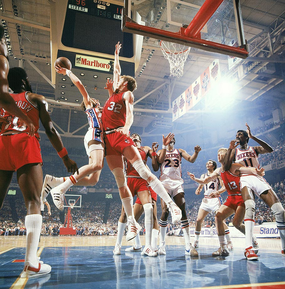 d87ef3ee14b Bill Walton of the Trail Blazers contests a shot by Doug Collins of the  76ers.