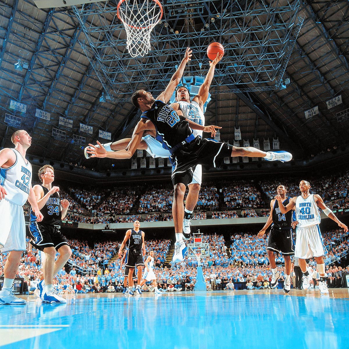 Chapel Hill, N.C., March 4, 2001 | Casey Sanders of Duke (20) tries to stop North Carolina's Julius Peppers at the Dean E. Smith Center. No. 2 Duke defeated No. 4 North Carolina 95-81.
