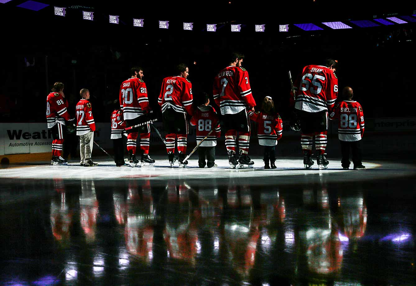 The Blackhawks and their linemates from the Make-a-Wish Foundation and Bear Necessities' Bears Hugs Program stood tall at Chicago's United Center before a game against the Ottawa Senators on Oct. 26, 2014.