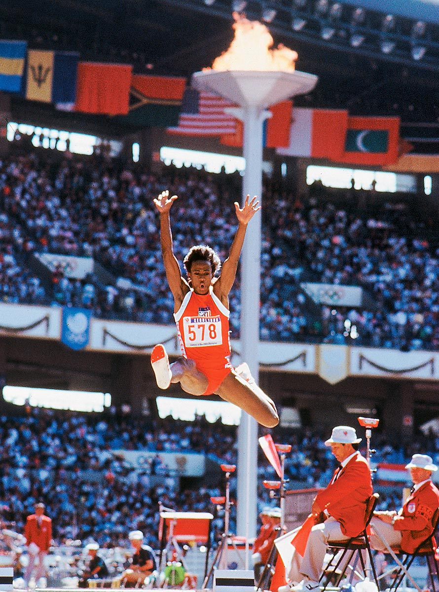Summer Olympics, Sept. 29, 1988 | Four-time gold medalist Jackie Joyner-Kersee leaps for a then Olympic record 7.40 meters in the long jump during the 1988 Summer Olympics in Seoul, Korea. Though plagued by steroid accusations at the '88 Games, Joyner-Kersee never tested positive for performance enhancing drugs.