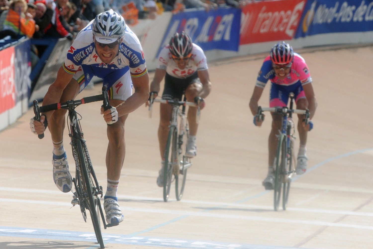 "Tom Boonen sprints for the second of his record-tying four wins in this race, in 2008. That sprint finish in the Roubaix velodrome kicked off the sublime rivalry between Boonen and Fabian Cancellara, seen here digging for second. Between them, ""Tommeke"" and ""Spartacus"" have won the seven of the last nine editions of this race."