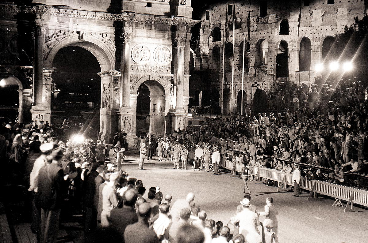 Rome Olympics, Sept. 10, 1960 | Barefooted runner Abebe Bikila of Ethiopia approaches the Arch of Constantine on his way to winning the Olympic marathon in world-record time of 2:15:16.2. The race was held at night due to sweltering summer heat.