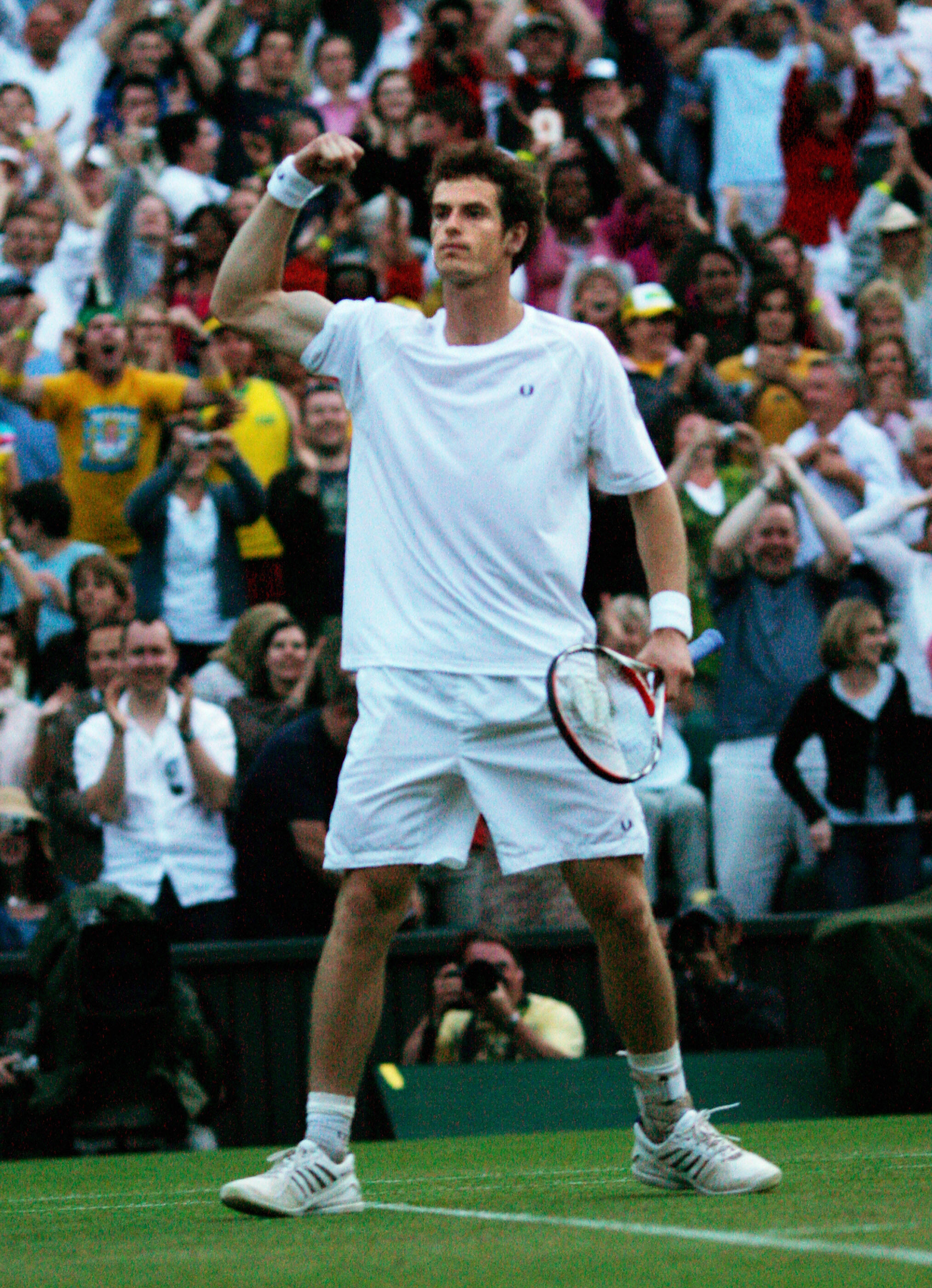 In all-white, during one of his most memorable wins at Wimbledon. He rallied from 0-2 down to beat Richard Gasquet as light began to fade on Centre Court.