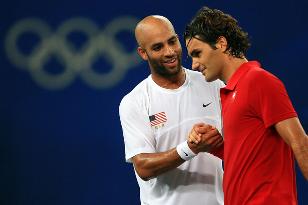 Blake shakes hands with Federer after his win in the men's tennis quarterfinals.