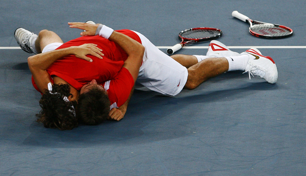 Federer and Wawrinka celebrate after defeating Thomas Johansson and Simon Aspelin of Sweden during the men's doubles gold medal match.