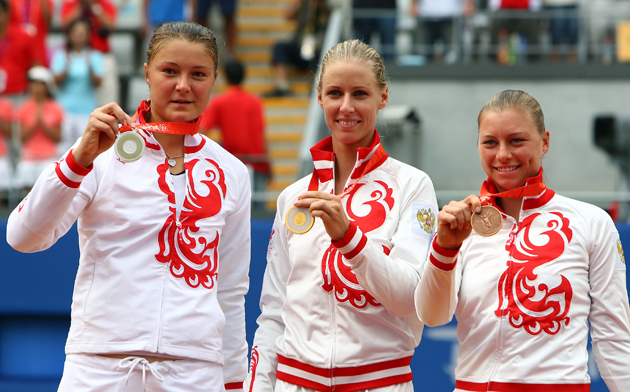 Silver medalist Dinara Safina, gold medalist Elena Dementieva and bronze medalist Vera Zvonareva pose together.