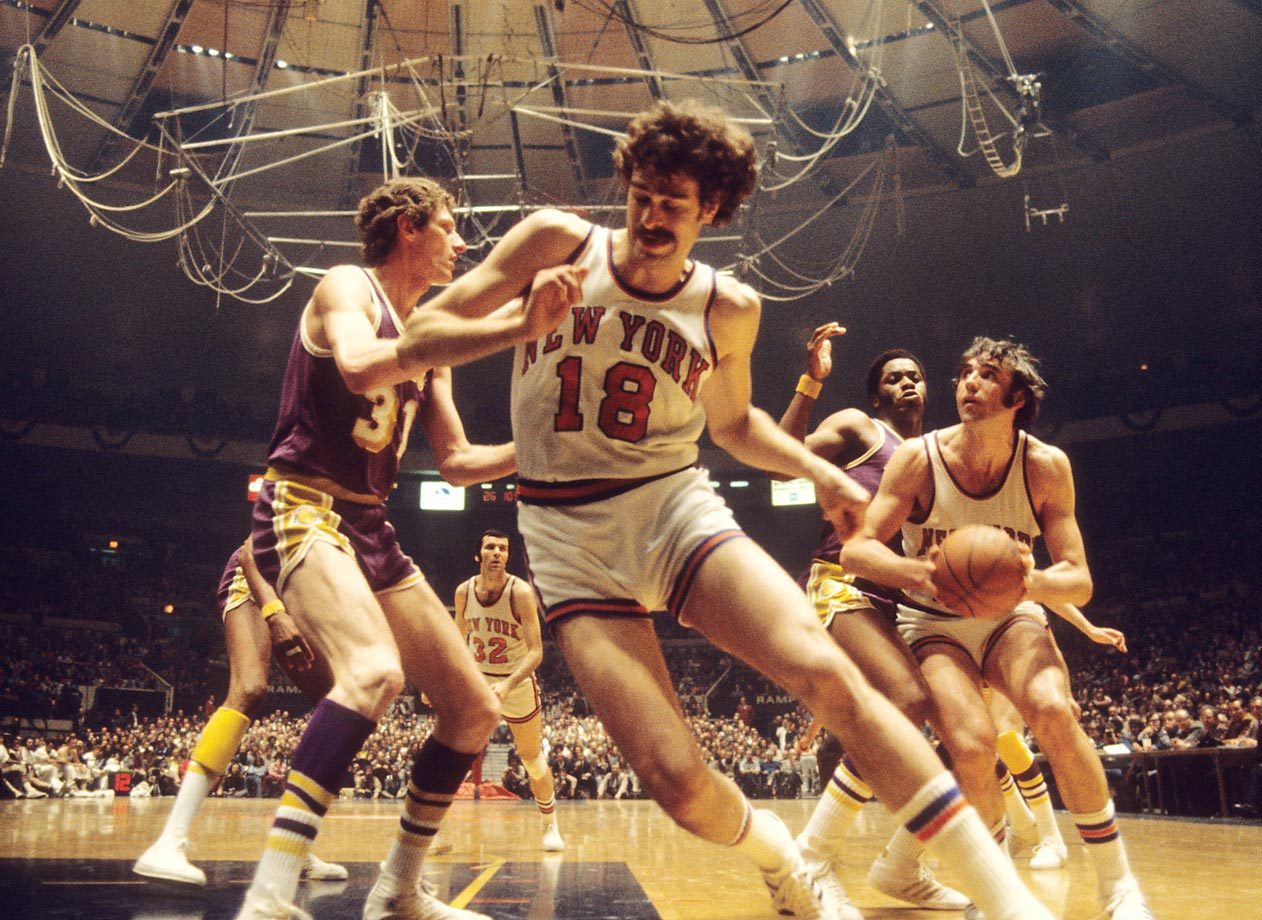Knicks Dave DeBusschere (with ball) and Phil Jackson (18) in action against Lakers Jim McMillian and Mel Counts (31) during Game 3. The Knicks would win 87-83.