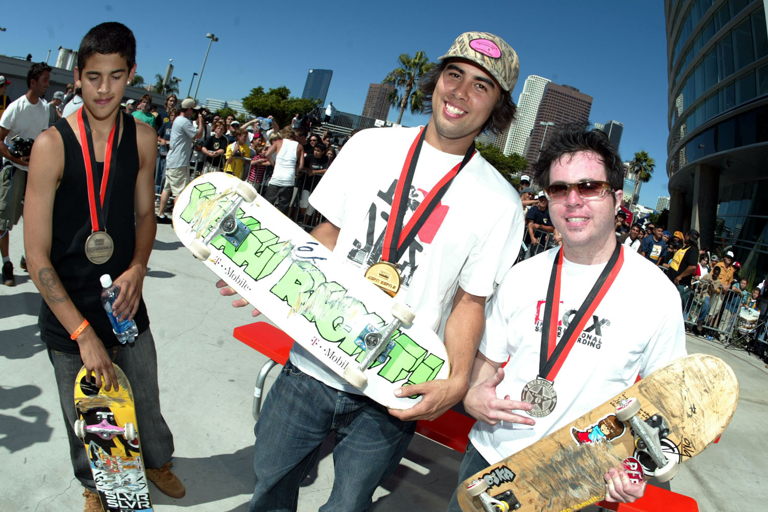 Paul Rodriguez, Eric Koston and Rodil de Araujo, Jr. pose for photographers during the awards ceremony at the X Games 9 Skateboard Street contest held at the Staples Center in Los Angeles, California.
