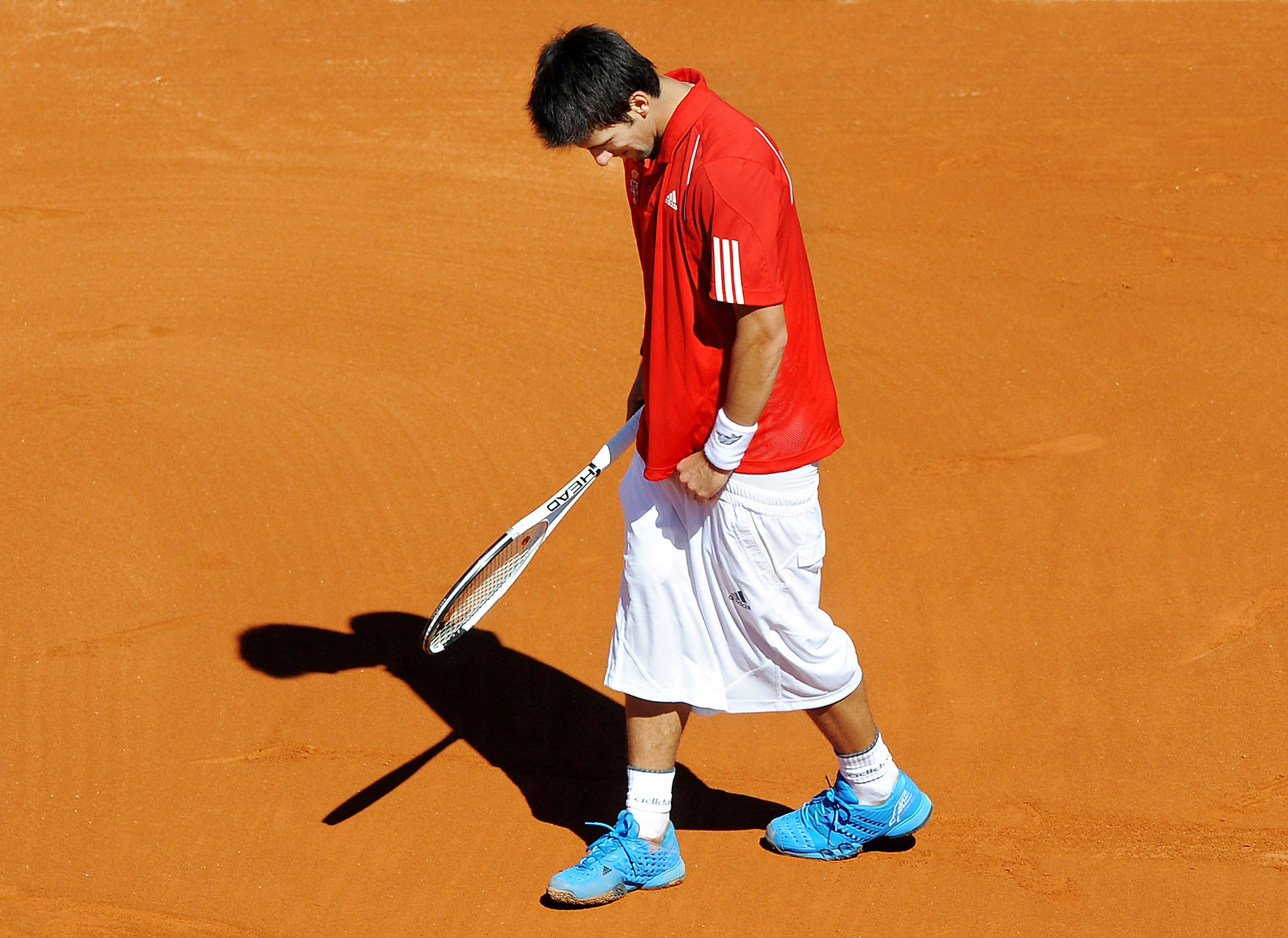 ...The shorts almost falling off? Not so much. Davis Cup will do this to you.