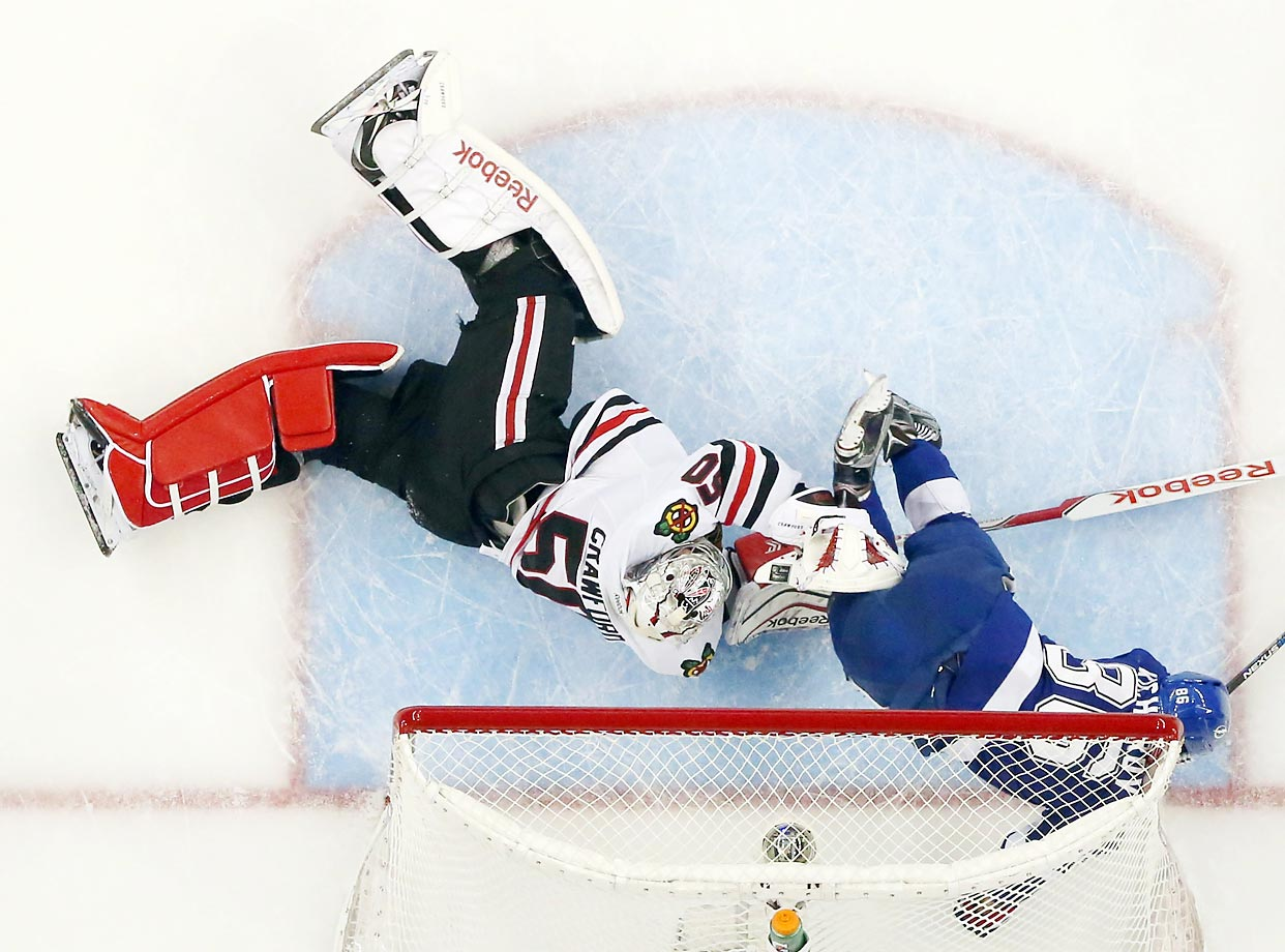 Nikita Kucherov of the Tampa Bay Lightning hits the goal post and collides with Chicago Blackhawks goalie Corey Crawford in Game 5 of the Stanley Cup Final.