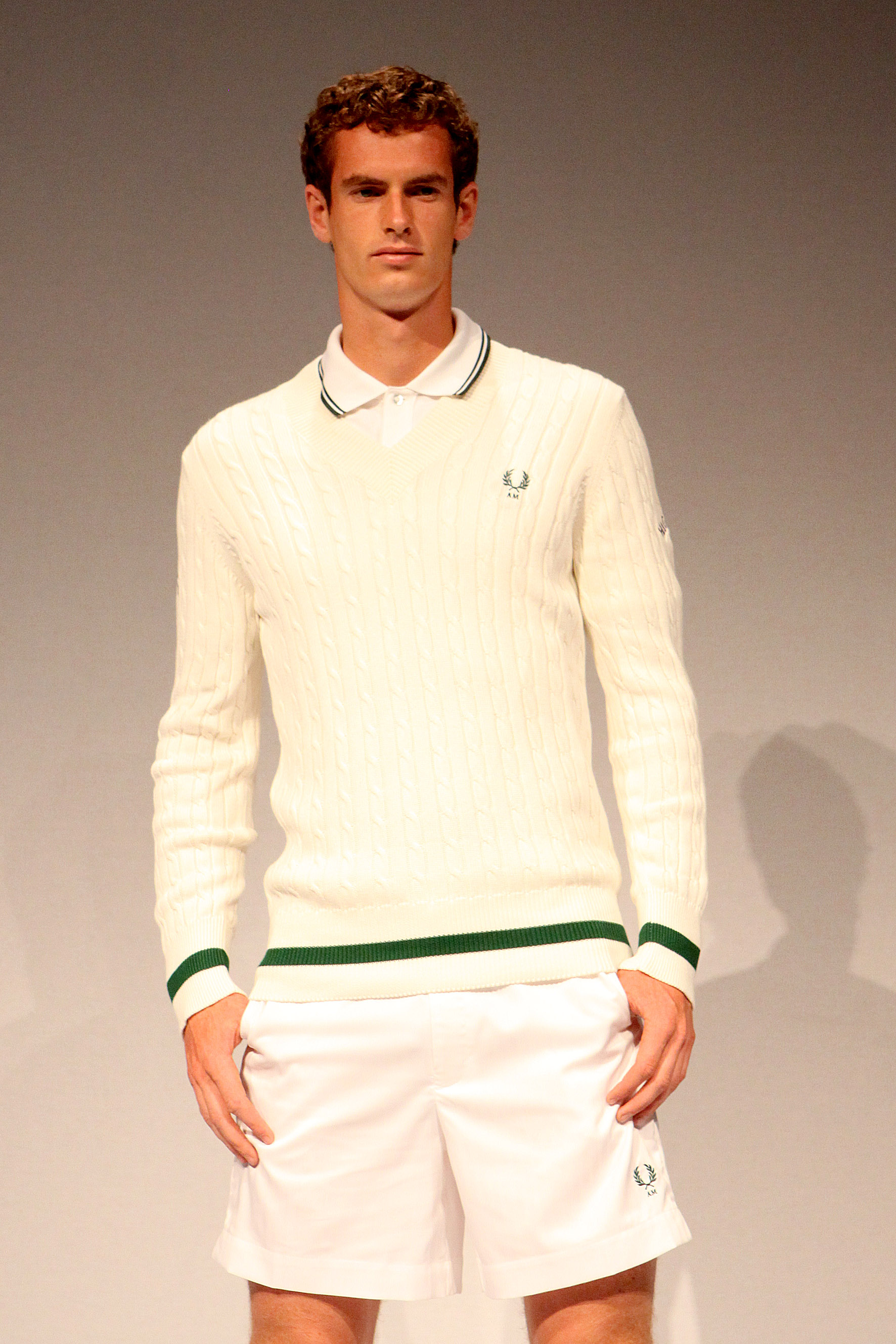 Fred Perry tries to put Murray in a sweater.